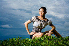 Outdoor shot of fashion model squatting Stock Images