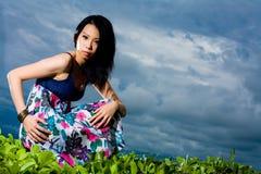 Outdoor shot of fashion model squatting Stock Photo
