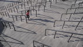 Outdoor shot of fit young woman running up stairs. Female athlete climbing up the steps. stock video footage