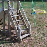 Handmade wooden childrens slide. Outdoor shot of a handmade wooden children slide , square composition royalty free stock photo