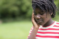 Outdoor Shot Of Stressed Teenage Girl royalty free stock image