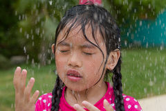 Outdoor shower. Young girl enjoying a outdoor shower on a hot day Stock Images
