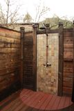 Outdoor shower. Private outdoor shower with wooden walls and tiles Royalty Free Stock Images