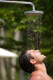 Outdoor shower. Man in the outdoor shower Royalty Free Stock Image