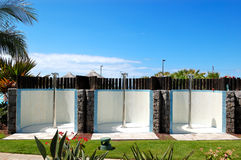 Outdoor showers near swimming pool and beach Royalty Free Stock Photography
