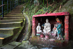 Outdoor shrine containing statues of the Goddess of Mercy and Guan Yu, Hong Kong Royalty Free Stock Photography