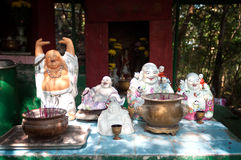 Outdoor shrine with statues of the Laughing Buddha, Hong Kong Stock Images