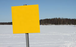 Outdoor sign. In winter landscape with frozen lake in background stock photography