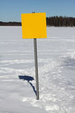 Outdoor sign. In winter landscape with frozen lake in background stock images