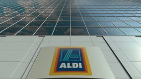 Signage board with Aldi logo. Modern office building facade time lapse. Editorial 3D rendering