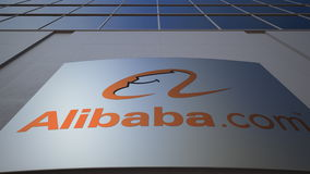 Outdoor signage board with Alibaba.com logo. Modern office building. Editorial 3D rendering Royalty Free Stock Photos