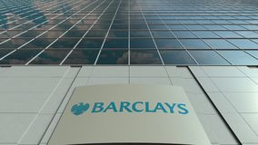 Signage board with Barclays logo. Modern office building facade time lapse. Editorial 3D rendering