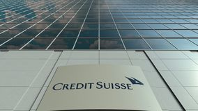 Signage board with Credit Suisse Group logo. Modern office building facade time lapse. Editorial 3D rendering