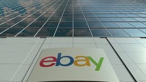 Signage board with eBay Inc. logo. Modern office building facade time lapse. Editorial 3D rendering