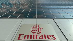 Signage board with Emirates Airline logo. Modern office building facade time lapse. Editorial 3D rendering. Outdoor signage board with Emirates Airline logo stock video