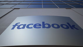 Outdoor signage board with Facebook logo. Modern office building. Editorial 3D rendering Royalty Free Stock Photo