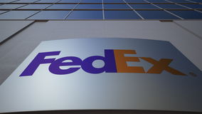 Outdoor signage board with FedEx logo. Modern office building. Editorial 3D rendering Stock Photography
