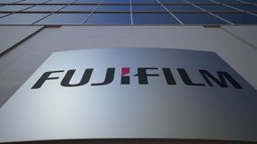 Outdoor signage board with Fujifilm logo. Modern office building. Editorial 3D rendering Stock Images