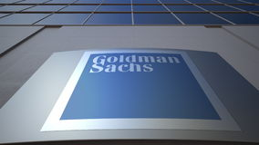 Outdoor signage board with The Goldman Sachs Group, Inc. logo. Modern office building. Editorial 3D rendering Royalty Free Stock Image