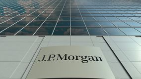 Signage board with J.P. Morgan logo. Modern office building facade time lapse. Editorial 3D rendering