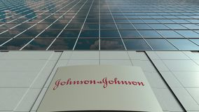 Signage board with Johnson and Johnson logo. Modern office building facade time lapse. Editorial 3D rendering