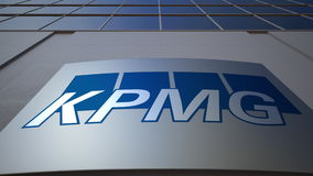 Outdoor signage board with KPMG logo. Modern office building. Editorial 3D rendering Royalty Free Stock Photos
