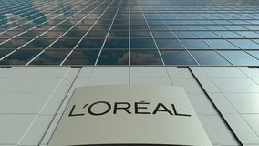 Signage board with L`Oreal logo. Modern office building facade time lapse. Editorial 3D rendering
