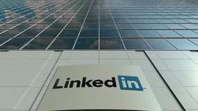 Signage board with LinkedIn logo. Modern office building facade time lapse. Editorial 3D rendering