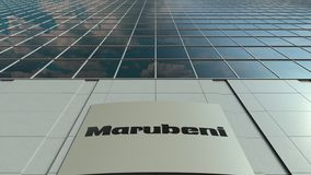 Signage board with Marubeni Corporation logo. Modern office building facade time lapse. Editorial 3D rendering
