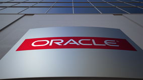 Outdoor signage board with Oracle Corporation logo. Modern office building. Editorial 3D rendering. Outdoor signage board with Oracle Corporation logo. Modern Stock Photos