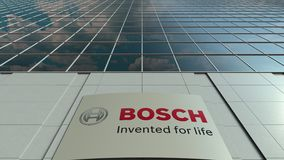 Signage board with Robert Bosch GmbH logo. Modern office building facade time lapse. Editorial 3D rendering