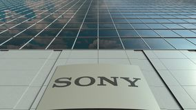 Signage board with Sony Corporation logo. Modern office building facade time lapse. Editorial 3D rendering. Outdoor signage board with Sony Corporation logo stock video footage