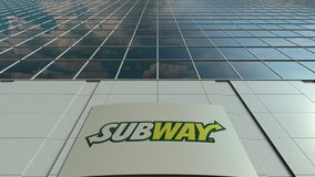 Signage board with Subway logo. Modern office building facade time lapse. Editorial 3D rendering