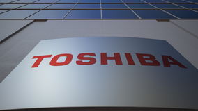 Outdoor signage board with Toshiba Corporation logo. Modern office building. Editorial 3D rendering. Outdoor signage board with Toshiba Corporation logo. Modern Royalty Free Stock Photos