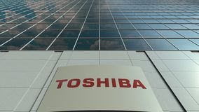 Signage board with Toshiba Corporation logo. Modern office building facade time lapse. Editorial 3D rendering. Outdoor signage board with Toshiba Corporation stock video