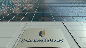 Signage board with UnitedHealth Group logo. Modern office building facade time lapse. Editorial 3D rendering