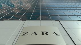 Signage board with Zara logo. Modern office building facade time lapse. Editorial 3D rendering