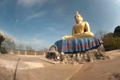 Outdoor sitting Buddha on top of Khao Tao temple near Khao Tao beach. Royalty Free Stock Image
