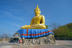 Outdoor sitting Buddha on top of Khao Tao temple near Khao Tao beach. Stock Photos