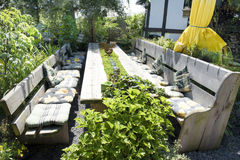 Garden patio with bench. Garden patio with table and bench for a great family stock photography