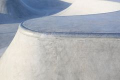 Skate park generic concrete ramps focus on ramp edge Royalty Free Stock Images