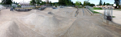 Outdoor Skatepark Panorama. A huge panoramic image of an empty cement skate park Stock Photo