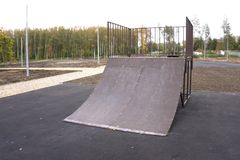 Outdoor skatepark with various ramps royalty free stock photo