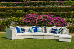 Outdoor sofa in the garden. Water resistant outdoor furniture with cushions and pillows Stock Photography