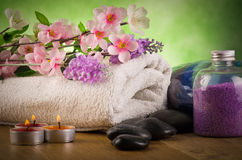Outdoor spa massage. Setting  with candlelight on green background Stock Photos