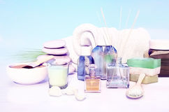 Outdoor spa massage setting at sunlight with candle. Horizontal Royalty Free Stock Photography