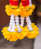 Outdoor spirit house in Thailand. garland and some wreathes. Outdoor spirit house in Thailand. spirit house in thailand with garland and some wreathes, joss Royalty Free Stock Photos