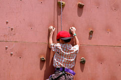 Outdoor sport. Kid climbing wall - outdoor sport royalty free stock image