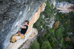 Outdoor sport activity. Rock climber ascending a challenging cli. Ff. Extreme sport climbing. A person achieving his goal Stock Images