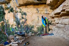 Outdoor sport activity.Rock climber on belay.Active leisure. Outdoor sport activity. Rock climber on a belay in beautiful rock area. Active leisure. Margalef Stock Photography